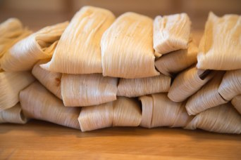 A stack of uncooked tamales ready for steaming