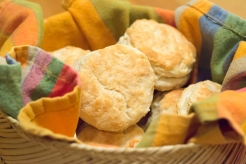 A basket of freshly-baked biscuits ready for the table