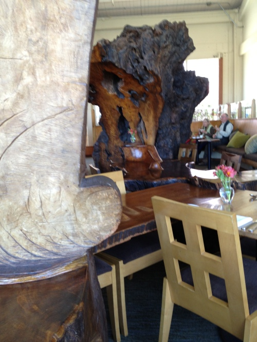 Greens Restaurant dining room with the massive tree trunk