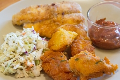 Fried catfish, hush puppies, coleslaw and cocktail sauce