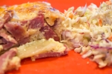 Ham and potato gratin served with a side of coleslaw