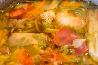 Making vegetable stock from frozen vegetable peelings and scraps