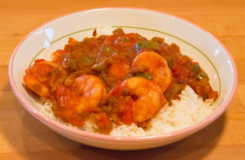 Finished shrimp Creole sauce served over cooked white rice. Add classic Louisiana hot sauce if you like.