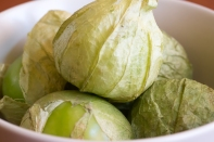 Tomatillos with their husks still on