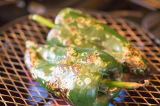Poblanos roasted and charred over open flame