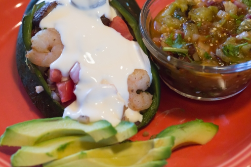 Shrimp-stuffed poblano with crema, tomatillo-chipotle salsa, and fresh avocado