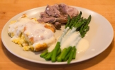 Spoonbread and asparagus with Mornay sauce, braised lamb shank