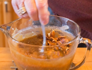 Stirring in the pecans and butter