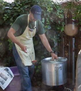 Chief cook checking how the boil is going