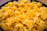 Sprinkle the grated Velveeta on top of the baked casserole and return to the oven