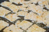 Saltines with butter ready for baking