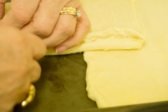 Preparing the puff pastry for the tart