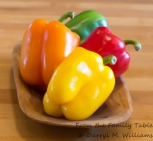 Green, red, orange, and yellow bell peppers