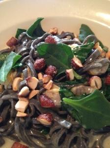 Black onion chitarra, manila clams, almond, spinach