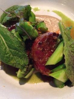 Glazed pork cotechino, asparagus, sour orange, sunchoke