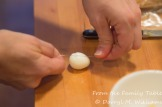 Using a cheese wire to cut the eggs in half
