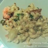 A serving of shrimp, mushroom, artichoke mac and cheese
