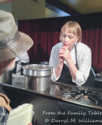 Sarah Rich talking with a participant at the cooking demonstration