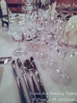 A flight of wine glasses lined up for the dinner and wine pairing