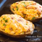 Baked potato stuffed with mixture of potato, pimento cheese spread, scallions, and bacon