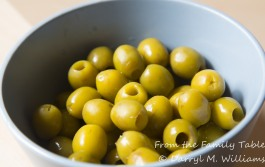 Pitted green olives ready to be cut up