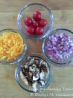 Clockwise: cherry tomatoes, red onion, crimini mushrooms, sharp Cheddar cheese