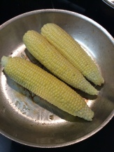 Fresh corn dry roasting in a hot sauté pan