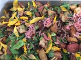 Honey-roasted potatoes, sunflower petals, leaves, and seeds