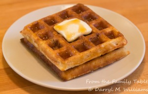 Roasted corn and bacon waffles with butter and maple syrup