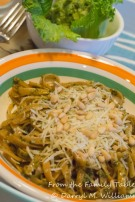 Fettuccine topped with Parmesan and toasted pine nuts