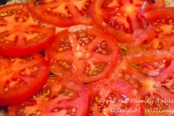 Tomato slices cooking in butter