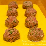 Meatballs formed and ready to roll in rice