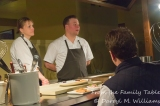 Sarah and Evan Rich in the demonstration kitchen answering a question from the audience