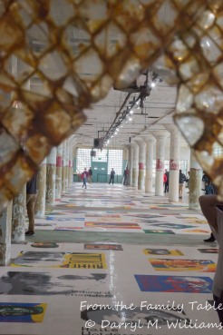View through a broken window pane of the display of Lego portraits of political prisoners
