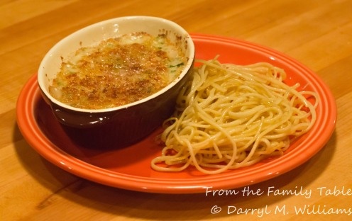Deviled crab and mushroom gratin with buttered spaghetti