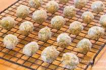 Breaded olives drying for 30 minutes before frying