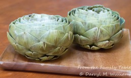 Artichokes trimmed, and with the choke removed, ready for stuffing