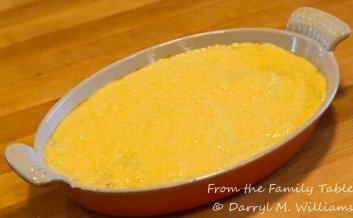 Cornbread batter on top, ready for the oven