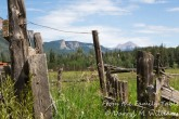 An old corral and the San Juan Mountains