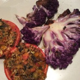 "Grilled cauliflower ""steaks"" with roasted stuffed tomatoes"