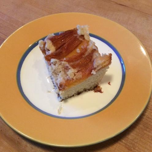 Warm peach pudding in a pool of heavy cream