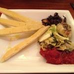 Bruschetta with tomato, artichoke, roasted garlic , and mushroom