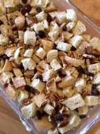 Bread cubes with raisins and pecans added, ready for the custard mixture.