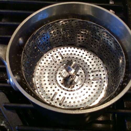 Saucepan with steamer basket