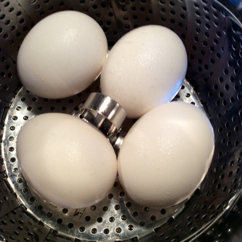 Eggs in the steamer basket ready to be cooked