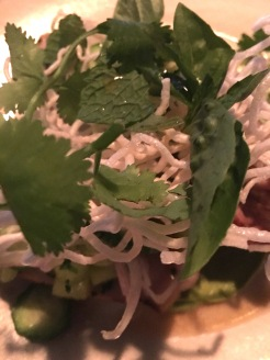 Pork chop, cucumber, avocado, crispy rice noodles