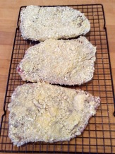 Steaks breaded with cracker crumbs ready for frying