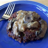 Salmon cake topped with mushroom sauce