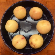 Poached peaches ready to be chilled