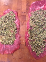 Flank steaks spread with filling
